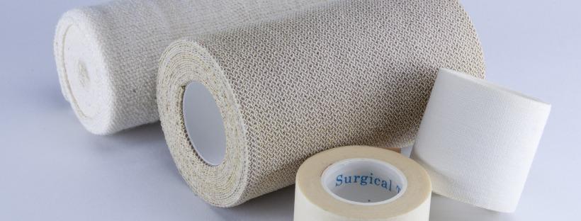 Photo: rolls of bandages, gauze, and medical tape